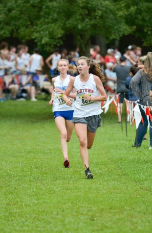 Freshman Cate Barton runs at Bob Blastow Early Bird Invitational Meet on Aug 28. She finished 9th with a time of 20:56.