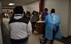 Students line up for optional Covid-19 testing. As the virus continues to spread, APS is now requiring teachers and staff to undergo surveillance testing twice a week. While the move is a step in the right direction, more must be done to ensure public safety in schools.