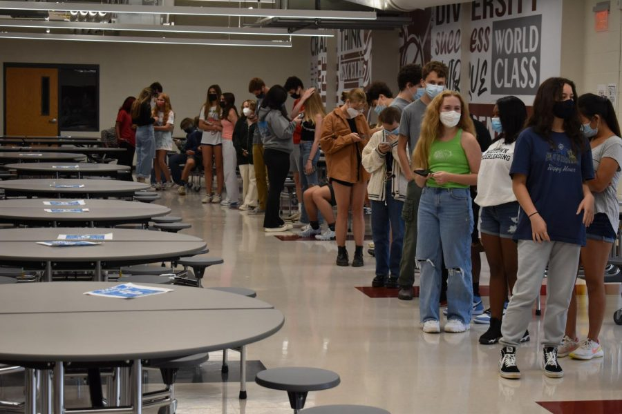 Students wait in line to get tested for Covid-19. Testing is run by Viral Solutions and happens every Friday.