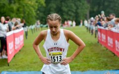 Sophomore and individual champion Cary Schroeder catches her breath after finishing the race.