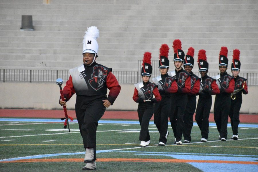 Neighbors leads Midtowns Marching Band at the JV Football game on Oct. 14 against Therrell High School.