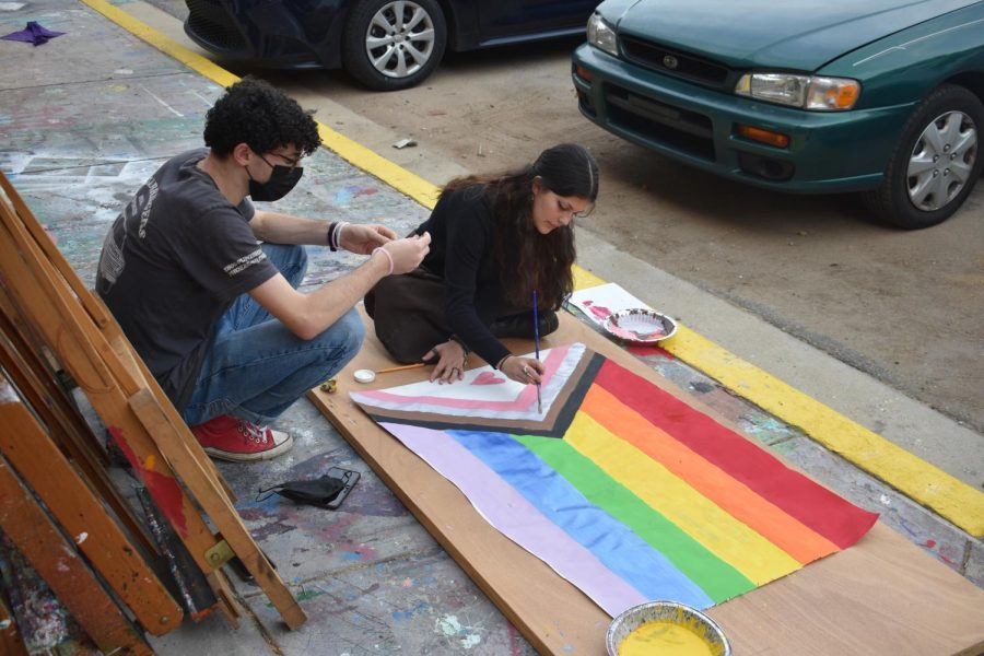 Seniors Brody Weiss (left) and Georgia Rice paint a Pride flag for the Gender-Sexuality Alliance Pride event. The event will take place on Oct. 29, from 5:30-8 p.m.
