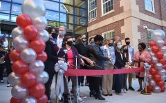 School board members,  APS administrators, Midtown students and Principal Dr. Betsy Midtown administrators line up for the ribbon-cutting to mark the recent addition to the school.