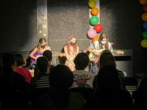 Evelyn Lowry (left), Stella Raio (middle) and Sam Offutt (right) performed Harvest Moon by Neil Young.