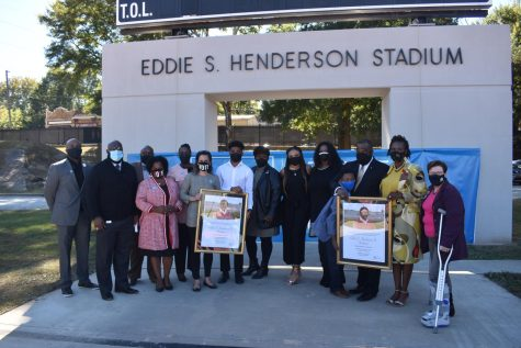 Family members and friends of Eddie S. Henderson are joined by APS administrators and board members at the stadium renaming ceremony.